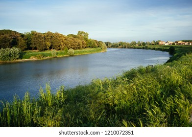 Arno river at the entrance of Pisa city, Italy