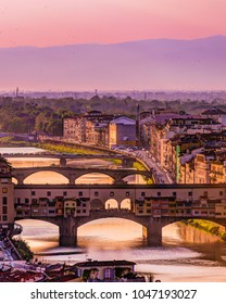 Arno river in Florence sunset / Italy View to Ponte Vecchio from Michelangelo square