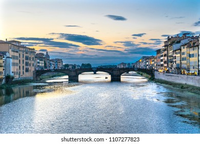 Arno River Ponte Santa Trinita Evening Florence Italy. View from Ponte Vecchio.  Oldest eliptical arch bridge in the World from Renaissance