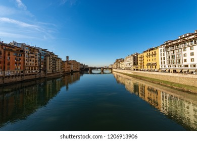 The Arno River and the Santa Trinita Bridge (XVI century) view from the Ponte Vecchio in the downtown of Florence (Fiirenze), Tuscany, Italy, Europe