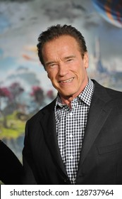 """Arnold Schwarzenegger at the world premiere of Disney's """"Oz: The Great and Powerful"""" at the El Capitan Theatre, Hollywood. February 13, 2013  Los Angeles, CA Picture: Paul Smith"""