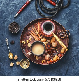 aroma Arab hookah with coffee in vintage style.View top