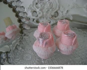 aroma bath bomb pink white truffle rose silver glitter sparkle mirror glass plate vintage background ornate cupcake