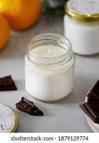 Aroma candle in a glass jar with the aroma of chocolate. The aroma of chocolate. winter atmosphere. winter scents. The aroma of citrus and chocolate. - Shutterstock ID 1879129774
