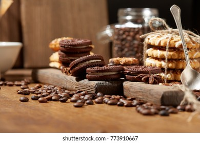 Aroma coffee candy chocolate cookies and spices on the wooden table. Christmas sweets. Dark wooden background. Top view. Close. Closeup.