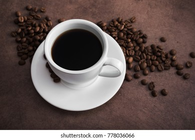 Aroma coffee cup with roasted beans on vintage old background
