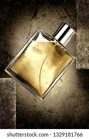 Aroma. Creative concept photo of beauty product luxury male perfume fragrance eau de toilette lotion scented water cologne in a transparent spray bottle on stone grey background.