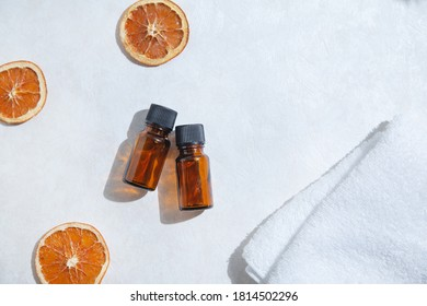 Aroma Materials. Two bottles of aromatic oil. An orange of dried fruit. A bird's-eye view.