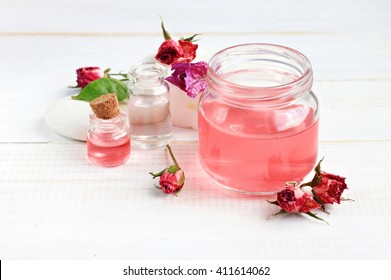 Aroma rose water for skincare, essential oils, jar and bottle, dried flowers.