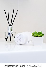 Aromatherapy bottle diffuser with sticks. Modern style aroma sticks bottle in bathroom interior. Natural aromatherapy concept