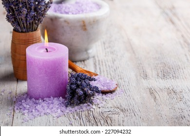 Aromatherapy concept, candle with lavender flowers
