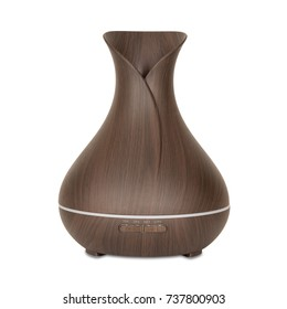 Aromatherapy Concept. Wooden Electric Ultrasonic Essential Oil Aroma Diffuser and Humidifier on a white background