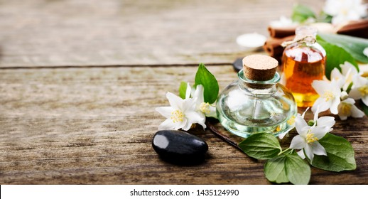 Aromatherapy with essential and massage organic oil handmade with jasmine, cinnamon and vanilla. Wellness center design background. Spa treatment product.
