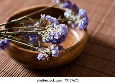 Aromatherapy flower lavender over woden bowl.