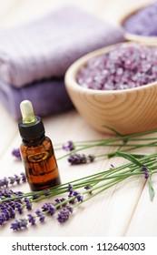 aromatherapy oil andbowl of lavender bath salt - beauty treatment