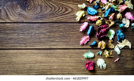 aromatherapy potpourri mix of dried aromatic flowers on wooden background with copy space