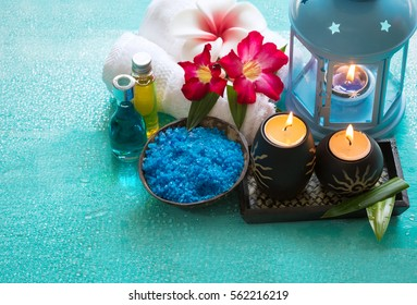 Aromatherapy product Spa set ,candle ,salt soap,towel,flower, massage ,on drop of water,wood background .