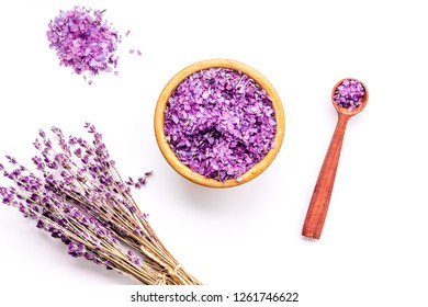 Aromatherapy. Purple spa salt near dry lavender branches on white background top view