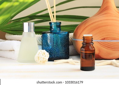 Aromatherapy set. Essential oil, glass bottles, aroma diffuser, relaxing spa, natural home fragrances.