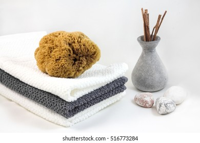 Aromatherapy and SPA concept. Towel and sea sponge.