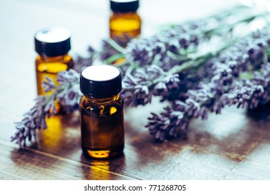 Aromatherapy tools, bottles with oil and lavender flowers