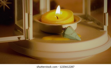 Aromatherapy: yellow cande with turchese stone in a Magic Lantern