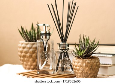 Aromatic air freshener in a transparent glass bottle with life tree symbol
