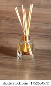 Aromatic air freshener in a transparent glass bottle with cinnamon