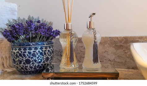 Aromatic air freshener in a transparent glass bottle with lavanda