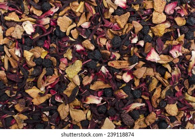 aromatic black dry tea with fruits and petals, isolated on white