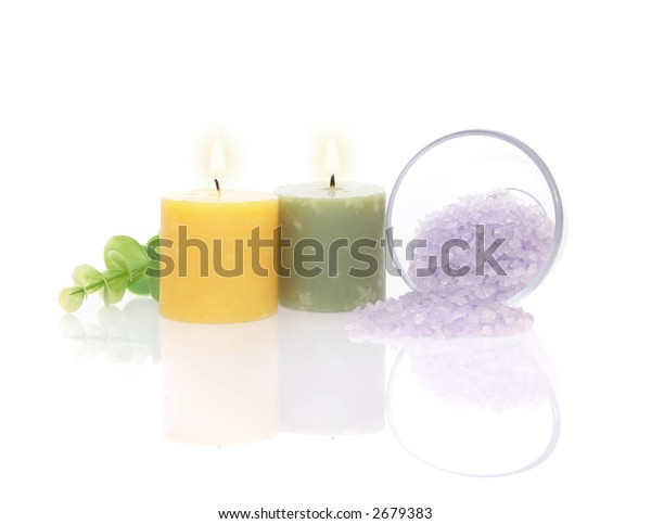 Aromatic Candles, Bath Salt and Green Leaf with reflection on white background