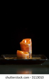 Aromatic candles on black background