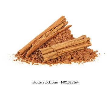 Aromatic cinnamon sticks and powder on a white background