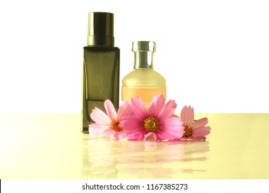 aromatic Essential oil perfume bottles with flower for cosmetics spa health nature concept