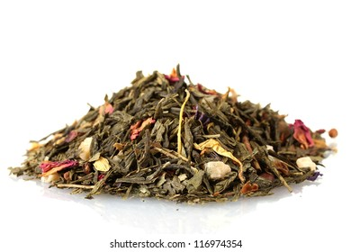 aromatic green dry tea with fruits and petals, isolated on white