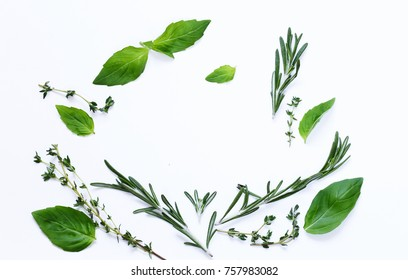 aromatic herbs - basil, thyme, rosemary on white background