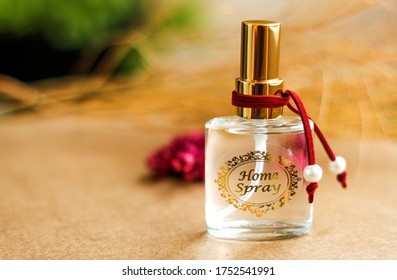 Aromatic home spray air freshener in a transparent mini glass bottle with decoration