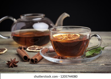aromatic hot cinnamon tea on wooden table