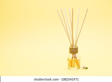 Aromatic Incense Oil Diffuser with Reed Sticks on a yellow background