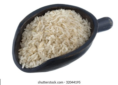 aromatic, long grain, Jasmine white rice grown in Thailand on a rustic wooden scoop, isolated on white
