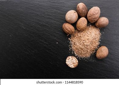 aromatic nutmeg on a dark stone background