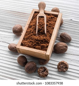 aromatic nutmeg on a gray wooden background.