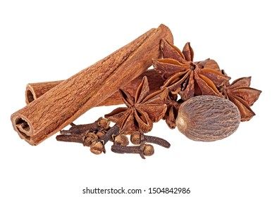 Aromatic spices isolated on a white background - cinnamon sticks, star anise, nutmeg and clove.