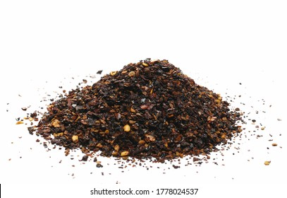 Aromatic spicy chili pepper flakes, dry ancho chili pile isolated on white background