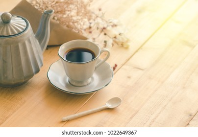 Aromatic tea on the wood table in the morning.