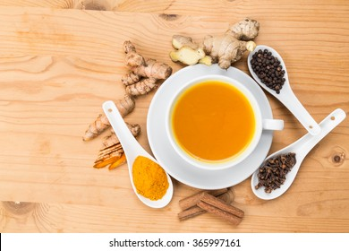 Aromatic turmeric tea with black pepper, cinnamon, cloves and ginger offers many wellness health benefits