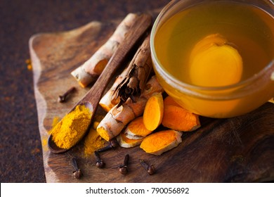 aromatic turmeric tea with cinnamon cloves and ginger - healthy eating