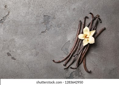 Aromatic vanilla sticks on grey background