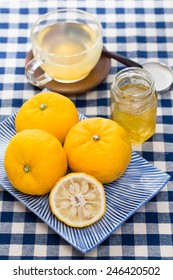 Aromatic zest of ripe fruits of yuzu combined with honey makes a syrup used to make yuzu tea (Yuzu cha, or Yujacha), a traditional Korean hot drink (herbal tea) popular in Japan.
