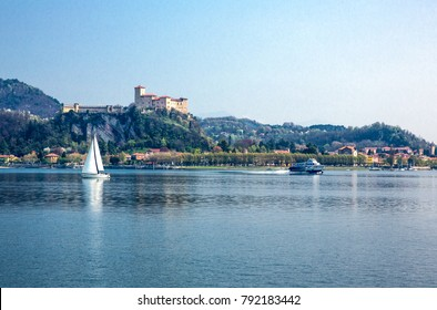 Arona, Italy - April 18, 2013: Panoramic view of the Maggiore lake with the Borromea fortress of Angera in the background